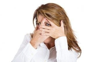 Closeup portrait, mature woman shy and flirting with hands covering entire face except one wide open eye looking at you, camera, isolated white background. Negative human emotion facial expressions