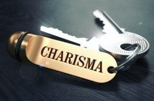 Charisma Concept. Keys with Golden Keyring on Black Wooden Table. Closeup View, Selective Focus, 3D Render. Toned Image.